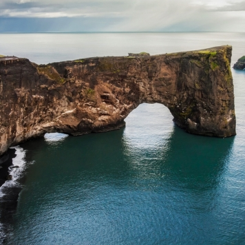 dyrholaey-arch-rock-formation-and-sea-in-iceland-380-small